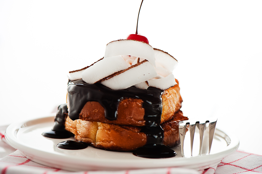 French toast with dark chocolate, white cream, red cherry, cocon